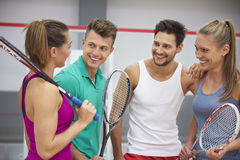 Playing squash with friends. Players talking about the results of the match Royalty Free Stock Photos