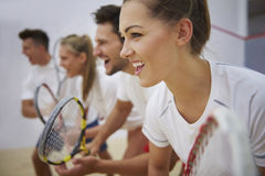 Playing squash with friends. Start the game with the aim of winning Royalty Free Stock Photo