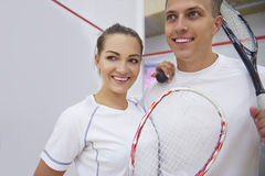 Playing squash with friends. Tired but happy after squash match Royalty Free Stock Photo