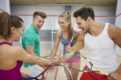 Playing squash with friends stock image