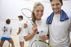 Playing squash with friends. Together we can do more Royalty Free Stock Images