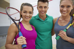 Playing squash with friends Stock Photo