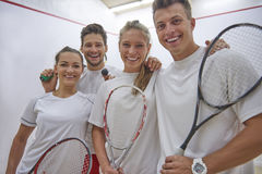 Playing squash with friends. Very successful team at a squash court Royalty Free Stock Photography