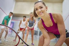 Playing squash with friends Royalty Free Stock Images