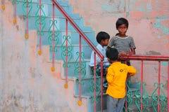 Playing on the steps. Boys playing on the steps alongside my hostel in Varanasi India Stock Photos