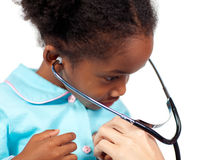 Playing with a stethoscope Royalty Free Stock Images