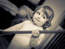 Playing with a stick. Portrait of a happy cute little baby playing at home Stock Photos