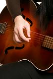 Playing strumming a guitar Stock Image