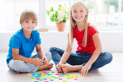 Playing and studying. Stock Images