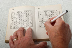 Playing Sudoku Royalty Free Stock Image