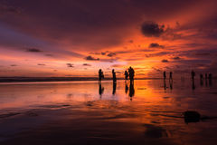Playing when the sun sets. People playing at the beach when the sun sets Royalty Free Stock Photography
