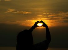 Playing sunshine. A heart with the light from the sun Stock Photography