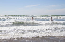 Playing in the surf stock image