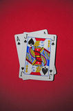 Playing table with black jack. Black Jack and Black Ace on the red playing table Stock Photography