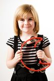 Playing tambourine Stock Photography