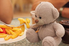 Playing with a teddy bear Royalty Free Stock Photo