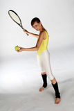 Playing tennis. A girl posing with a tennis racket royalty free stock images