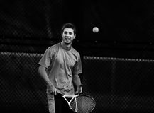 Playing Tennis. Athletic young man (in twenties) playing tennis Royalty Free Stock Photography