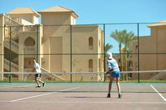 Playing at tennis court Royalty Free Stock Photo