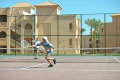 Playing at tennis court Royalty Free Stock Images