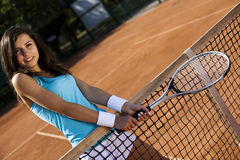 Playing tennis. Girl playing tennis on the court Royalty Free Stock Images