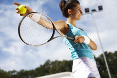 Playing tennis. Girl Playing Tennis, summertime saturated theme Stock Images