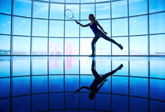 Playing tennis in gym Royalty Free Stock Photos