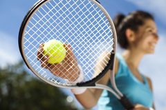Playing tennis. Summertime saturated theme Stock Images