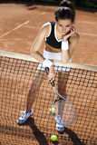 Playing tennis. Summertime saturated theme Royalty Free Stock Photos