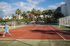 Playing Tennis. Two men playing tennis - holiday resort - Los Gigantes, Tenerife, Canary Island, Spain Royalty Free Stock Photography