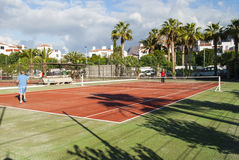 Playing Tennis. Two men playing tennis - holiday resort - Los Gigantes, Tenerife, Canary Island, Spain Stock Image