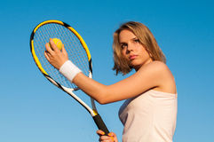 Playing Tennis. Woman playing tennis on the tennis court Royalty Free Stock Image