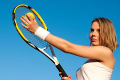 Playing Tennis. Woman playing tennis on the tennis court Royalty Free Stock Photo