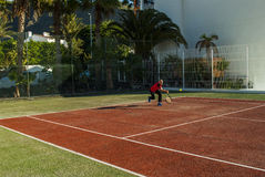 Playing Tennis. Young man playing tennis - holiday resort - Los Gigantes, Tenerife, Canary Island, Spain Stock Photography