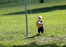 Playing tether ball Royalty Free Stock Images