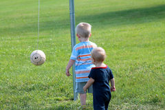 Playing tether ball Royalty Free Stock Photography