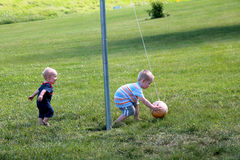 Playing tether ball Royalty Free Stock Photos