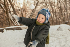 Playing throwing snowballs. Stock Image