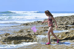Playing in tidepools Stock Photo