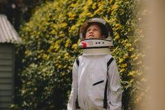 Playing to be an astronaut stock photos