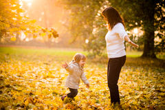 Playing together in autumn nature Royalty Free Stock Photography