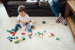 Playing with Toy Blocks at Home Stock Photo
