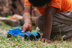 Playing with a toy car Royalty Free Stock Photo