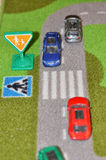 Playing with toy cars Royalty Free Stock Image
