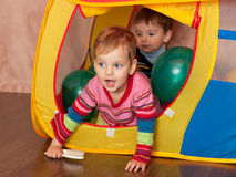 Playing in a toy house Royalty Free Stock Images