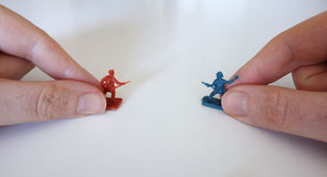 Playing with toy soldiers Stock Photo