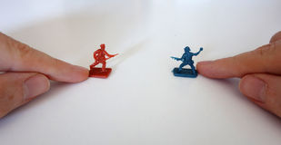 Playing with toy soldiers Royalty Free Stock Photos