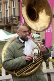 Playing the Tuba - Yorkshire - England. A street musician playing the tuba at a market in the town of Malton in North Yorkshire in the United Kingdom Royalty Free Stock Photography