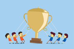 Playing tug of war for get the golden trophy Stock Image