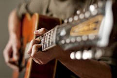 Playing a twelve string acoustic guitar Royalty Free Stock Photos